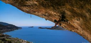 Loucas Dourdourekas flying across Inshallah 8c+ in North Cape climbing sector, Kalymnos Island Greece